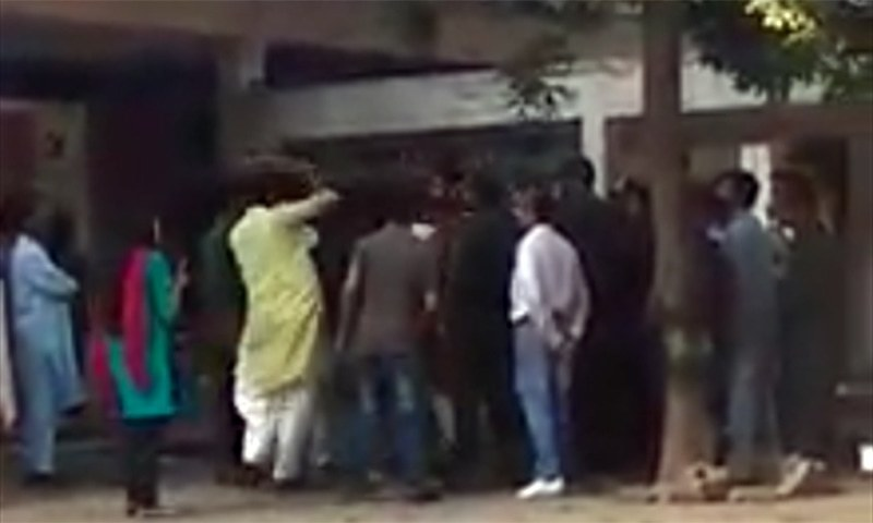 A screengrab of the viral video showing IJT students in Punjab University beating a man.