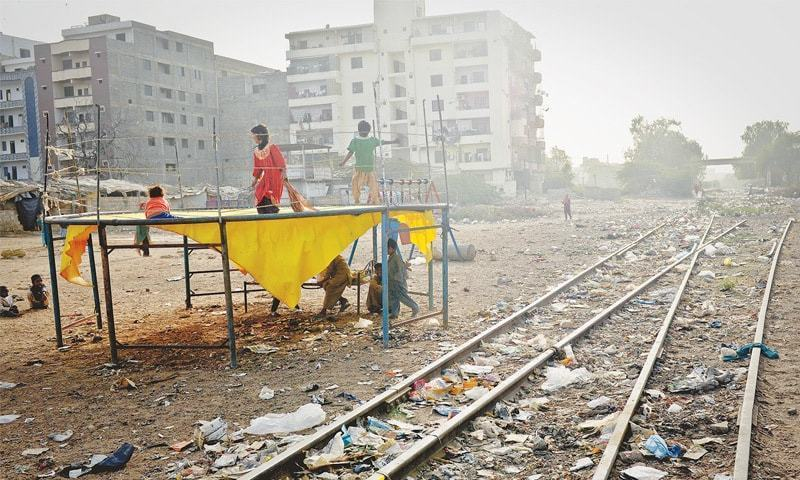 Children play on the trampoline set up close to the abandoned tracks near the Gilani railway station in Gulshan-i-Iqbal.—White Star