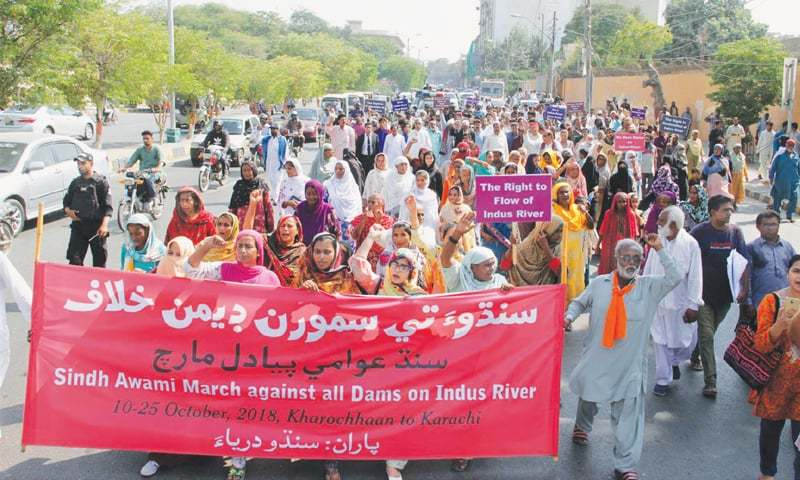 Participants in a 'long march' that originated in Kharochhan, Thatta district, on Oct 10 proceed towards Governor House on Thursday. The rally demanded that no more dams be built on the Indus. — PPI