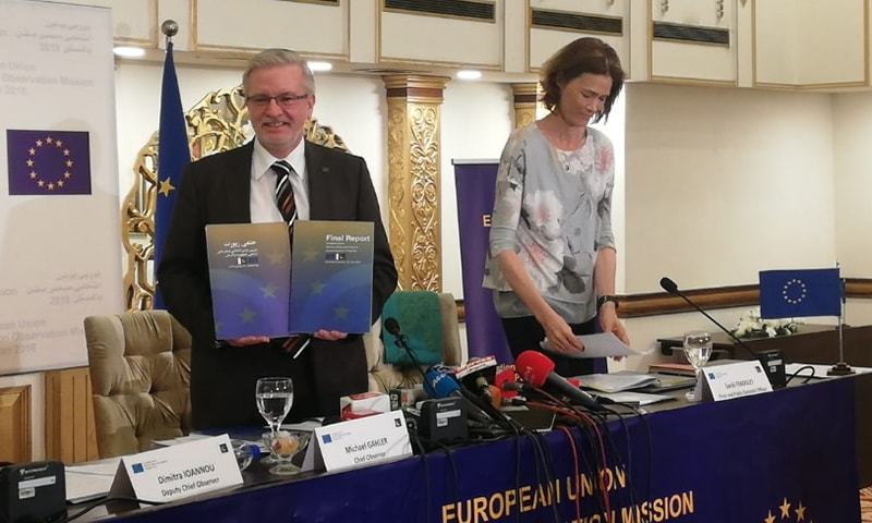Gahler posing with the EU EOM report on the July 25 elections. —Photo provided by author