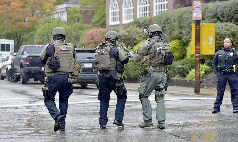 Police respond to an active shooter situation at the Tree of Life synagogue on Wildins Avenue in the Squirrel Hill neighborhood of Pittsburgh, Pa., on Saturday. — AP