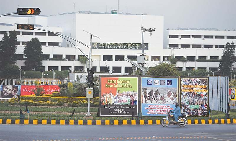 ISLAMABAD: Billboards inscribed with slogans for rights of the people of India-held Kashmir are displayed outside Parliament House to mark the 'Kashmir Black Day' on Saturday.—Photo by Tanveer Shahzad/White Star