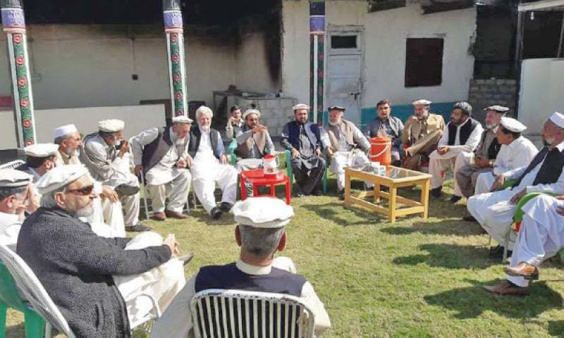 Elders discuss police deployment at a meeting in Bajaur on Sunday. — Dawn