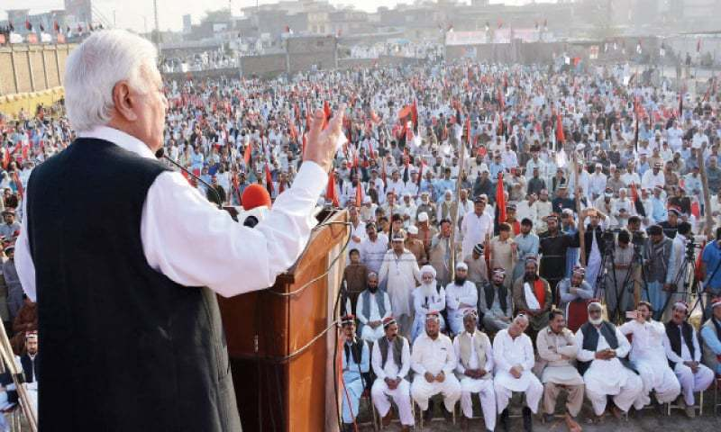 Aftab Sherpao addresses a public meeting in Peshawar on Sunday. — White Star