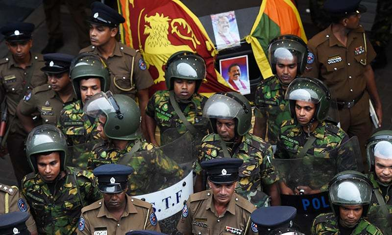 Sri Lankan soldiers keep watch outside the ceylon petroleum corporation in Colombo on October 28, 2018. — AFP