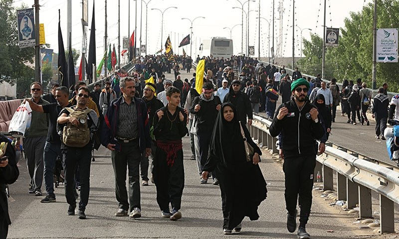 In this October 28 photo, pilgrims march to holy shrines for Arbaeen, outside Karbala, Iraq. — AP