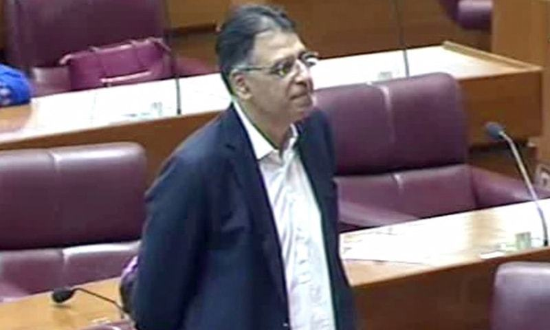 Finance Minister Asad Umar briefs parliament on loans being pursued by the government. — DawnNewsTV