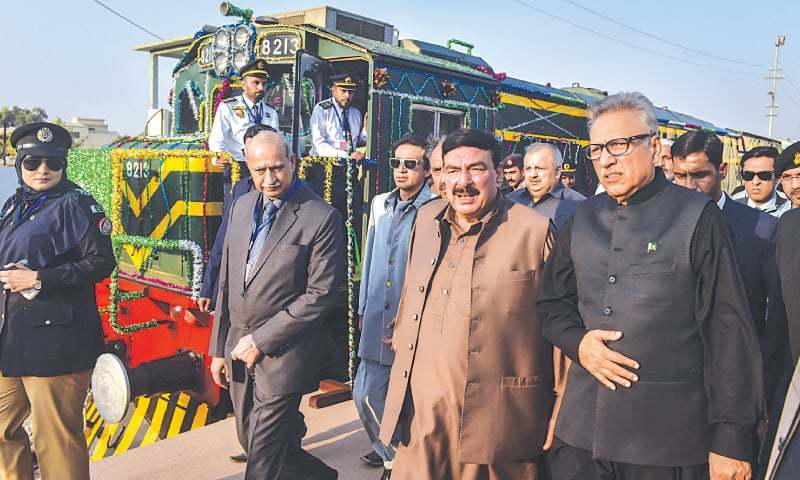 THE president, accompanied by the Railways minister, walks by the newly inaugurated train on Wednesday while (right) the interior of one of the carriages.—Fahim Siddiqi/White Star