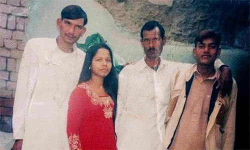 Asia Bibi with her family.— File