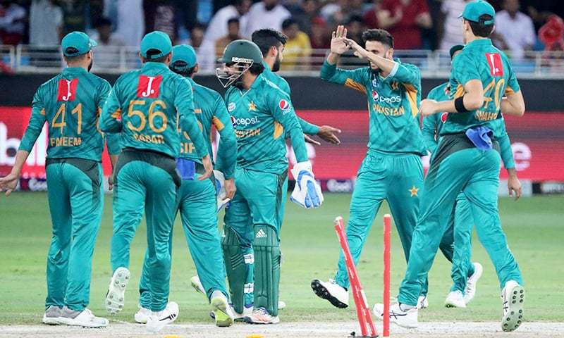 Pakistan team mates celebrate at the end of the match. —AFP