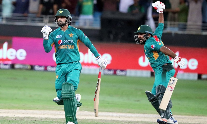 Mohammed Hafeez and Safaraz Ahmed celebrate after winning T20 match against New Zealand.  —AFP