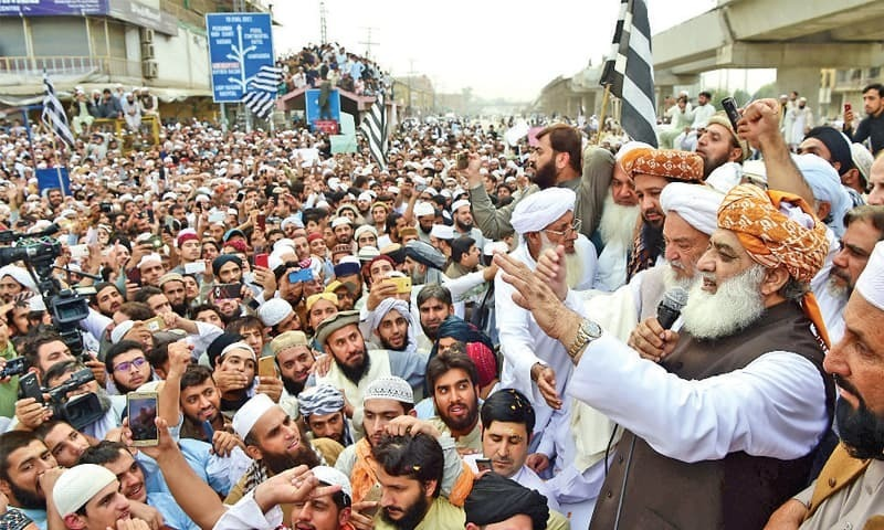 Maulana Fazlur Rehman addresses a protest rally at Firdaus Chowk, Peshawar, on Friday. — White Star