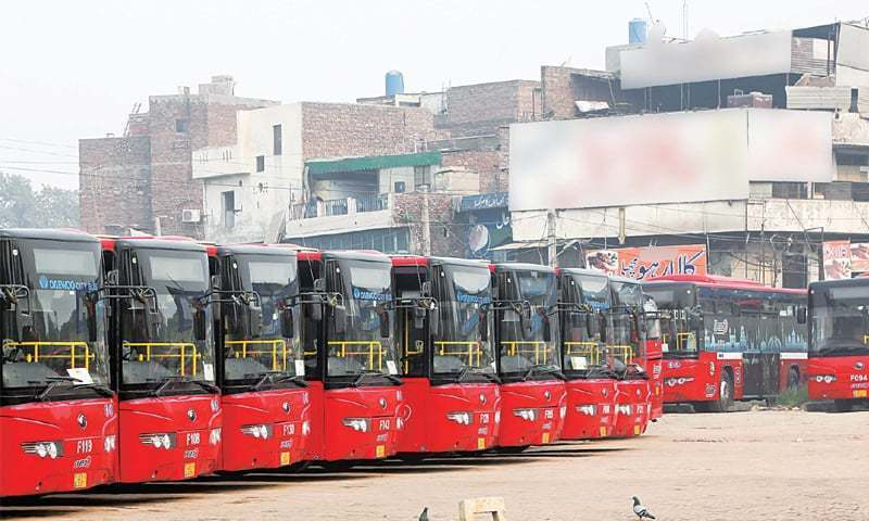 Buses parked at a depot near the railway station on Saturday after roads blockade in the city due to a protest by activists of a religious party. — File Photo