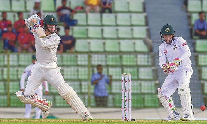 SYLHET: Zimbabwe batsman Sean Williams steers the ball during innings of 88 as Bangladesh wicket-keeper Mushfiqur Rahim watches in the first Test at the Sylhet International Cricket Stadium on Saturday.—AFP