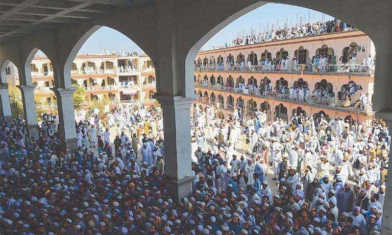 A large number of people gather in Darul Uloom Haqqania, Akora Khattak, to attend the funeral prayer for Maulana Samiul Haq on Saturday.—AFP