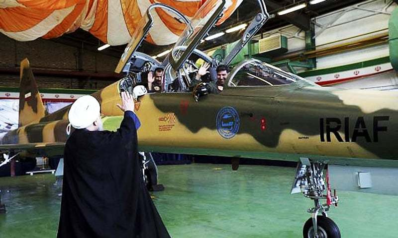 n this file photo, Iranian President Hassan Rouhani waves to the pilots of a fighter jet.—AP /File