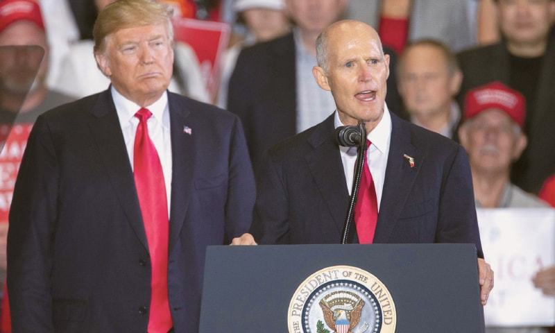 Florida governor and US senatorial candidate Rick Scott speaks as US President Donald Trump watches at a campaign rally in Pensacola, Florida, on Saturday. Republican Rick Scott's contest against incumbent Democrat Bill Nelson is the most expensive Senate race. — AFP
