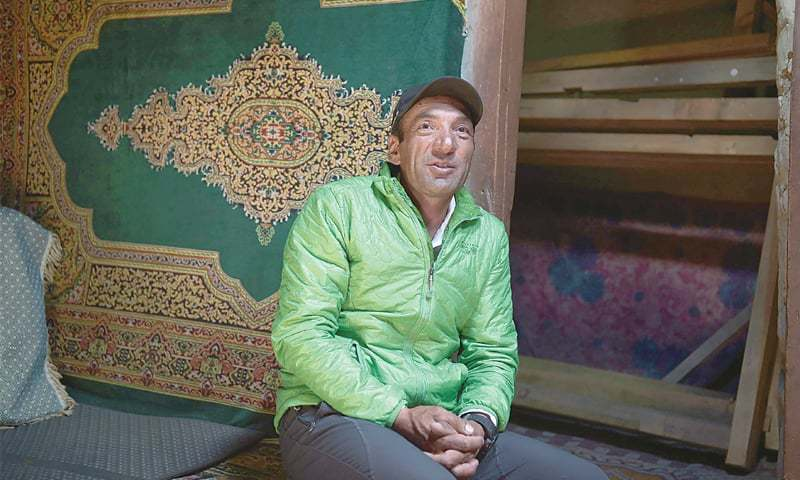 IN this picture dated May 5, Fazal Ali, who has climbed K-2 three times, talks to his friends in his house in Shimshal village of  Hunza valley.—AFP