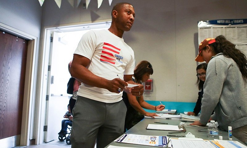 Johnathon Ervin prepares to cast his ballot a polling place during early voting in California's 25th Congressional district on November 4. — AFP