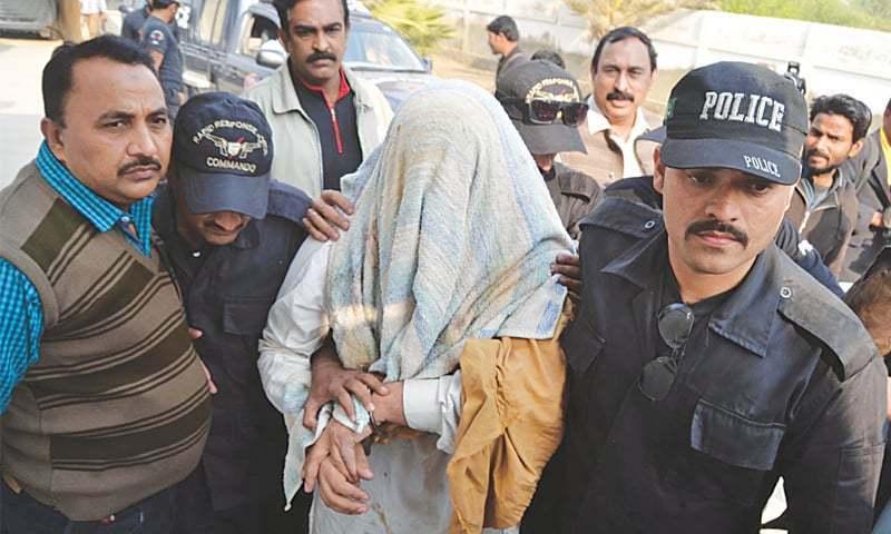 Karachi Police arresting a criminal. —File photo