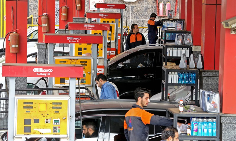 Iranians drivers fill their tanks at a gas station in the capital Tehran. —AFP