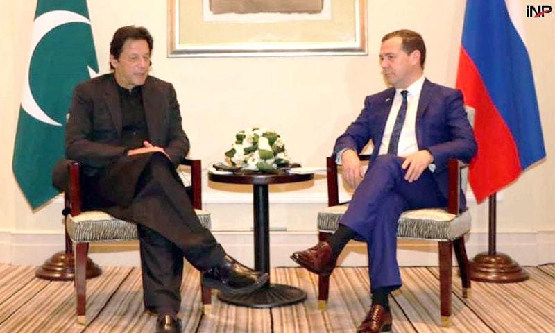 SHANGHAI: Prime Minister Imran Khan talks to Russian Premier Dmitry Medvedev on Monday.—INP