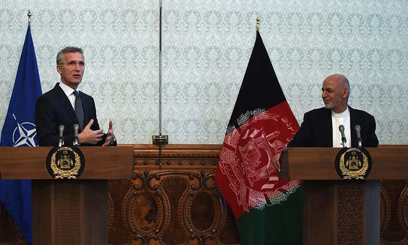 Secretary General of North Atlantic Treaty Organization (NATO) Jens Stoltenberg (L) gestures as he speaks during a joint press conference with Afghan President Ashraf Ghani (R). — AFP