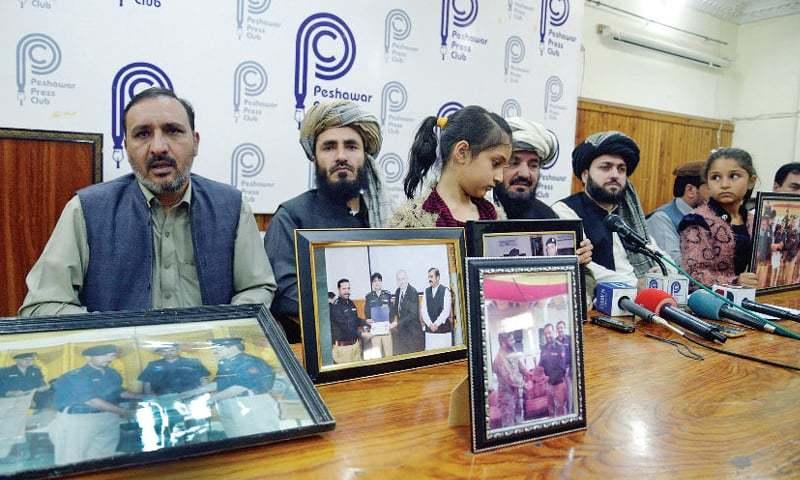 Family members of missing SP Tahir Khan Dawar address a presser at Peshawar Press Club on Tuesday. — White Star