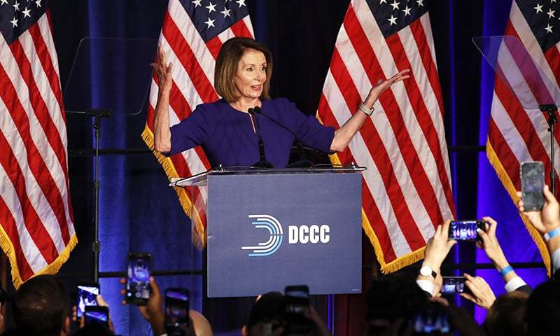 House Minority Leader Nancy Pelosi of California, smiles as she is cheered by a crowd of Democratic supporters during an election night returns event at the Hyatt Regency Hotel, on Nov 6, 2018, in Washington. ─ AP