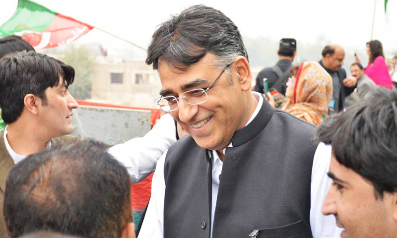 Finance Minister Asad Umar during a meet and greet with PTI supporters. —File photo