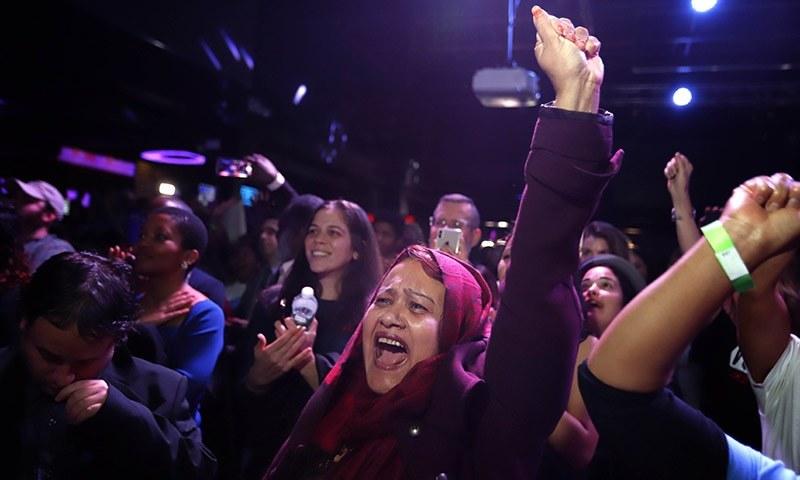 Mazeda Uddin celebrates the victory of Alexandria Ocasio-Cortez at La Boom night club in Queens on November 6, 2018 in New York City. — AFP