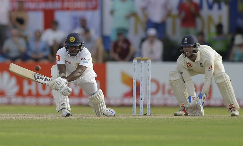Sri Lanka's Rangana Herath plays a shot as England's Ben Foakes watches during the second day of the first test cricket match between Sri Lanka and England in Galle, Sri Lanka on Wednesday. — AP