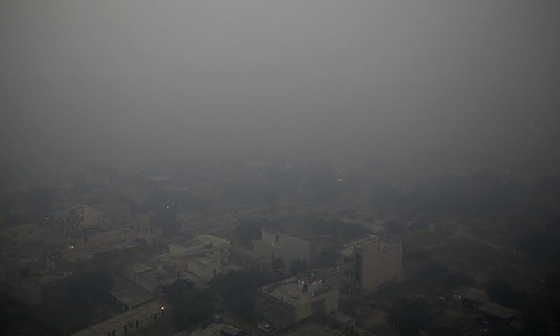 Morning haze envelops the skyline on the outskirts of New Delhi on Thursday. — AP
