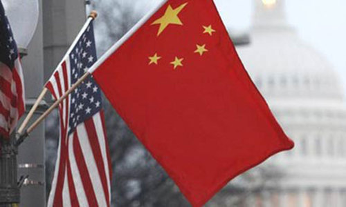 This file photo shows flags of China and US.