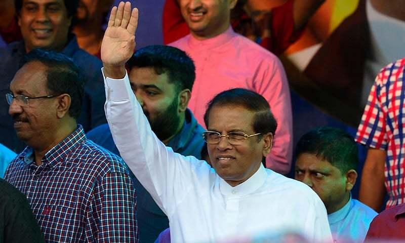 In this file photo Sri Lanka's President Maithripala Sirisena waves to supporters at a rally in Colombo. — AFP