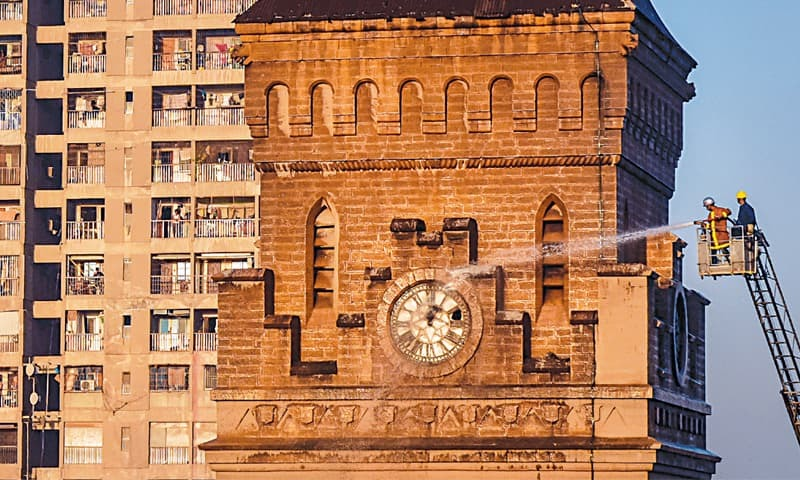 THE iconic Empress Market clock tower gets a much-needed wash with the help of a snorkel on Monday, following the anti-encroachment operation in the area.—Fahim Siddiqi/White Star