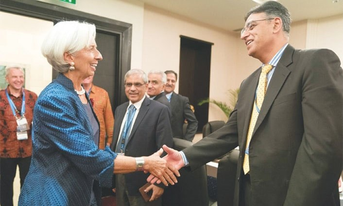 Finance Minister Asad Umar and IMF chief Christine Lagarde shake hands before their meeting on Thursday. — AFP/File