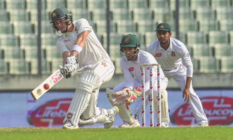 DHAKA: Zimbabwe's Peter Moor plays a shot as Bangladesh wicket-keeper Mushfiqur Rahim and slip fielder Mehidy Hasan look on during the second Test at the Sher-e-Bangla National Stadium on Tuesday. — AFP