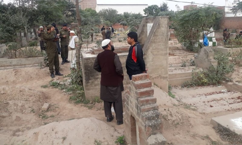 Bullet-riddled bodies of a woman and her two stepdaughters were found in a graveyard in the Shadbagh police precincts on Wednesday morning. Another stepdaughter was found injured with bullet wounds.  — Photo provided by police