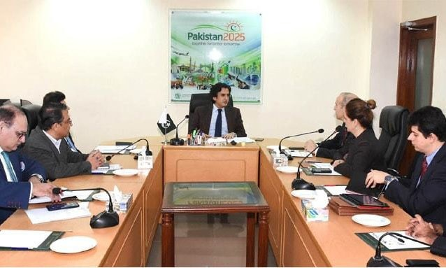 Islamabad:  Federal Minister for Planning, Development and Reform Makhdoom Khusro Bakhtyar talking to the IMF mission on Wednesday.