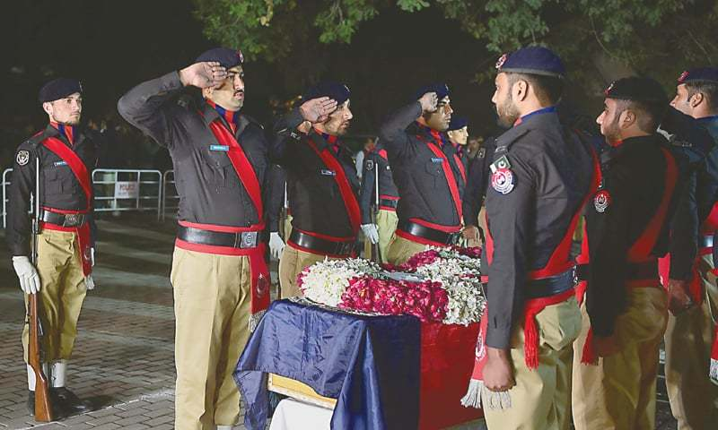 Police personnel pay their respects to the late SP Tahir Khan Dawar at the Police Lines Peshawar on Thursday. — Abdul Majeed Goraya / White Star