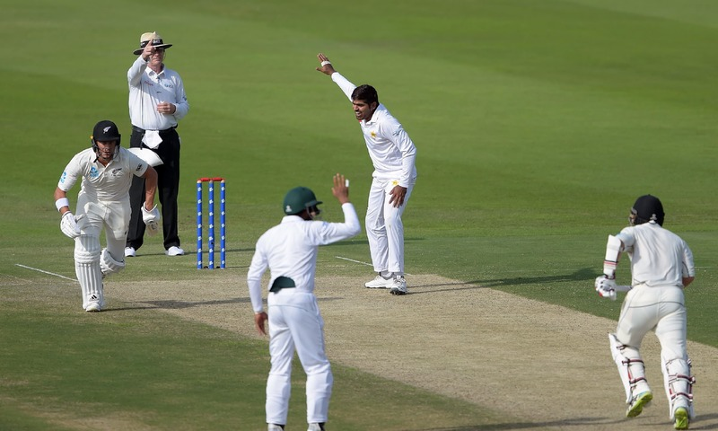 Haris Sohail celebrates after taking the wicket of New Zealand batsman BJ Watling during the first Test at the Sheikh Zayed International Cricket Stadium in Abu Dhabi. —AFP