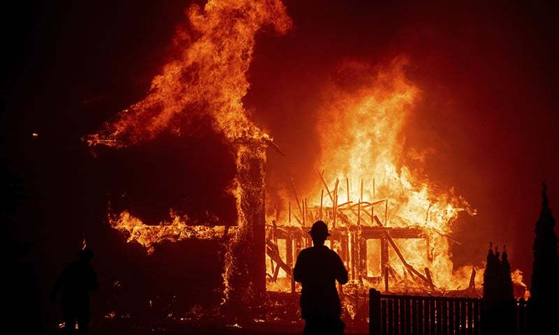 In this file photo, a home burns as the Camp Fire rages through Paradise, California. — AP