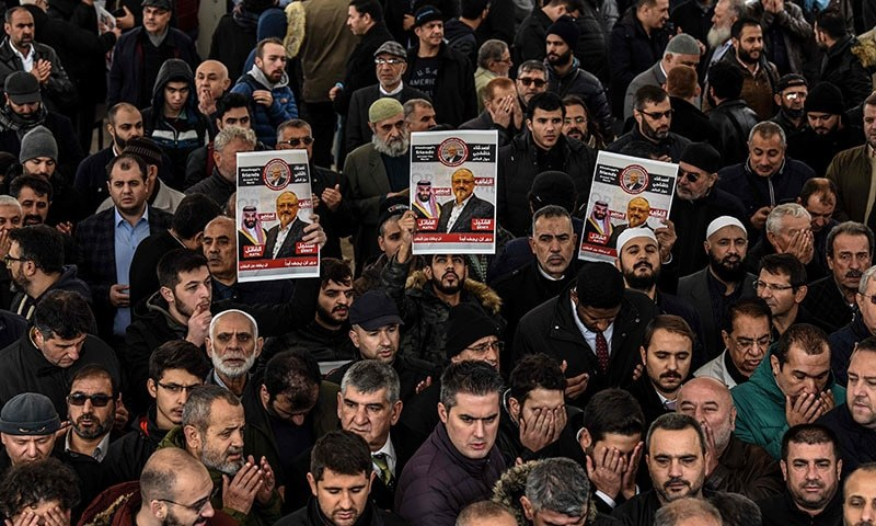 People hold banners of Jamal Khashoggi during a symbolic funeral prayer for the Saudi journalist at the courtyard of Fatih mosque in Istanbul on November 16. — AFP