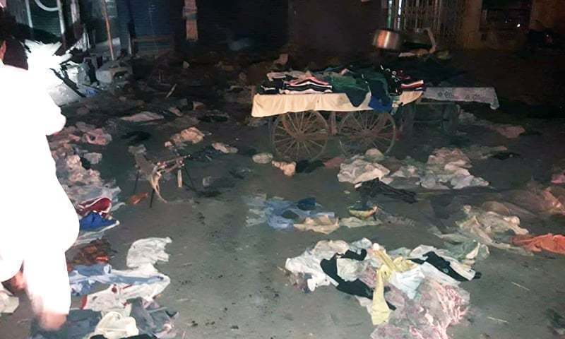 Clothes from roadside vendors strewn about at the site of the blast. —DawnNewsTV