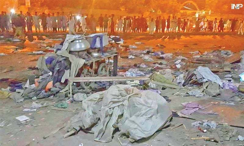 PEOPLE gather at the blast site on Friday night.—INP