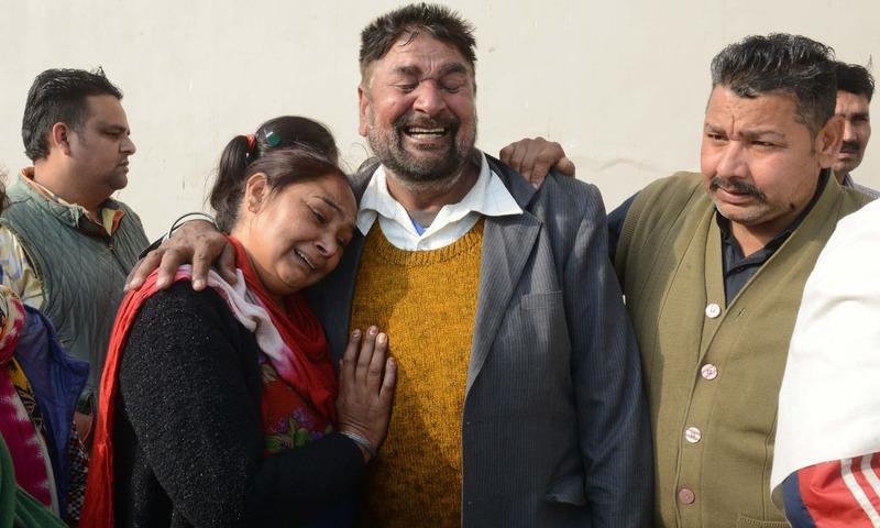Relatives of Sukhdev Singh, who was killed in a grenade attack at the Nirankari Satsang Bhawan, weep at a hospital in Amritsar. —AFP