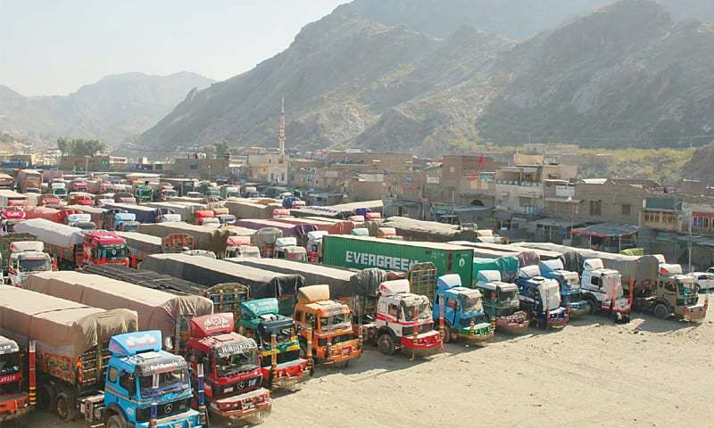 a large number of trucks loaded with goods are parked near the Torkham border .—PPI