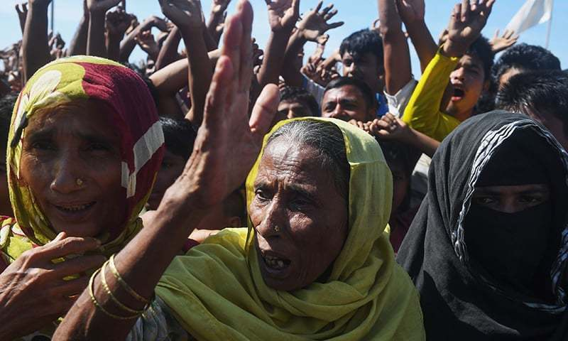Rohingya refugees shout slogans at a protest against a disputed repatriation programme at the Unchiprang refugee camp near Teknaf on November 15, 2018.  — AFP/File photo