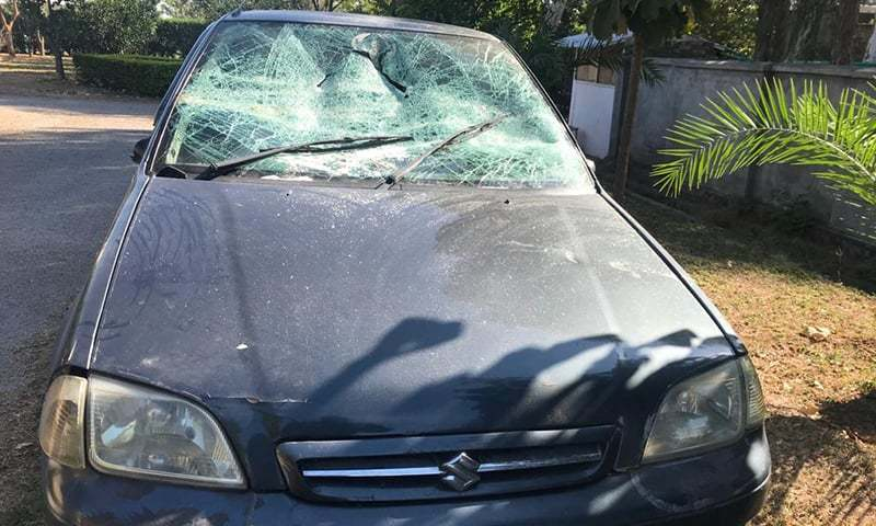 Cars damaged in clashes between student groups. — Photo provided by author
